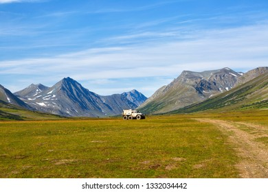 All-terrain vehicle rides on the road in the tundra, Yamal, Russia