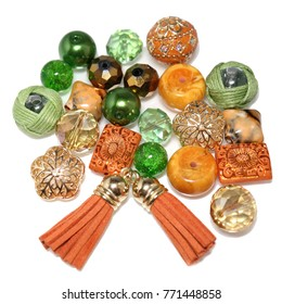 An alluring mix of orange & green glass beads in all shapes and sizes including round, oval, cubes. Ideal for making jewelry such as bracelets and necklaces.