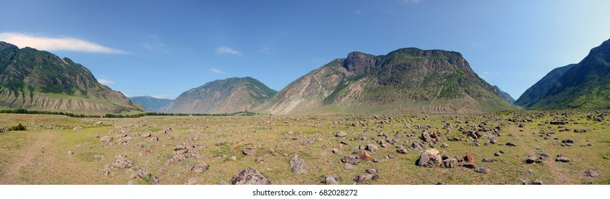 Alluvial fan. Cone of alluvial deposits of the Chulcha River in the valley of the Chulyshman River, Altai Mountains, Siberia, Russia. Large-sized panorama.
