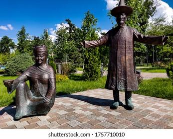 Alma Ata 2, Almaty / Kazakhstan - May 27 2019. Statue of kazakh woman and man in traditional clothing. Near Alma-Ata 2, Train Station.
