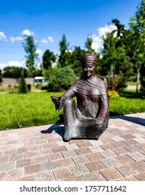 Alma Ata 2, Almaty / Kazakhstan - May 27 2019. Statue of kazakh woman in traditional clothing. Near Alma-Ata 2, Train Station.
