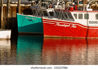 ALMA, NEW BRUNSWICK, CANADA - OCT 2009: Colorful lobster boats in the village of Alma, New Brunswick, Canada