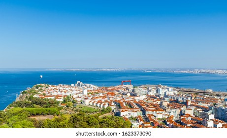 ALMADA, PORTUGAL - OCTOBER 10, 2019: Cityscape of Almada with river Tagus on a background.