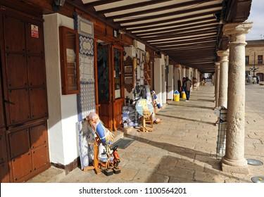 Almagro, Spain - Nov 22, 2010: Traditional craft shop open in the Plaza Mayor (Main Square) of Almagro, province of Ciudad Real, Castilla la Mancha, Spain