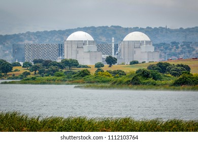 Almaraz, nuclear power plant in the center of Spain, surrounded by a green field