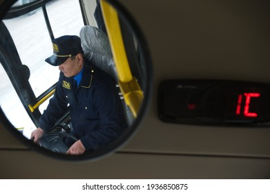 Almaty, Kazakhstan - 01.28.2014 : The city bus driver is reflected in the mirror