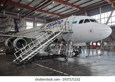 Almaty, Kazakhstan - 01.29.2014 : Air Astana Airbus A320 plane in hangar during repair