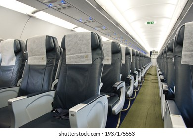Almaty, Kazakhstan - 01.29.2014 : The passage between the seats in the cabin of the Airbus A320 aircraft of the Air Astana airline