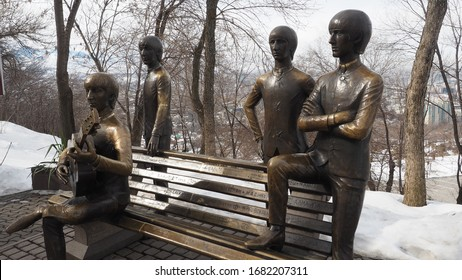 Almaty, Kazakhstan / 02.20.2020: Bronze monument to the English rock band The Beatles, on Mount Kok-Tyube. Sculptor Eduard Kazaryan. Standing - Paul McCartney, Ringo Starr, George Harrison, sitting