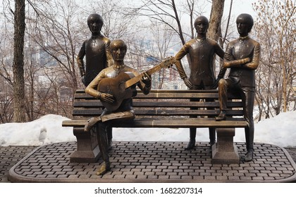 Almaty, Kazakhstan / 02.20.2020: Bronze monument to the English rock band The Beatles, on Mount Kok-Tyube. Sculptor Eduard Kazaryan. Standing - Paul McCartney, Ringo Starr, George Harrison, sitting