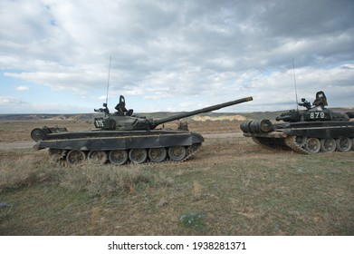 Almaty, Kazakhstan - 04.14.2014 : Soldiers on special vehicles and tanks on the field. Military exercises of various troops of the Republic of Kazakhstan