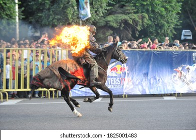 Almaty / Kazakhstan - 06.09.2012 : A stuntman performs a fire stunt on his back during a motorcycle show.