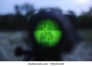 Almaty, Kazakhstan - 06.29.2013 : View through a night vision device in the scope of an airsoft gun.