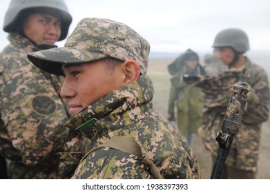 Almaty, Kazakhstan - 10.21.2014 : Military exercises of motorized rifle troops of the Kazakh army in an open field during the rain.