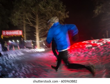 ALMATY, KAZAKHSTAN - 18 FEBRUARY 2017: Night competitions in the foothills of the city of Almaty, in the Trailrunning and Skyship discipline, which is called TunRun winter edition. Man running in the snow