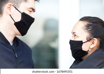 Almaty, Kazakhstan 20/03/2020:masked guy and girl look at each other  during corona virus