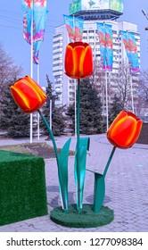 Almaty, Kazakhstan - 21 March 2017: Street installation of tulips at celebration of Nauryz. Words on flags: 'Happy Nauryz!'