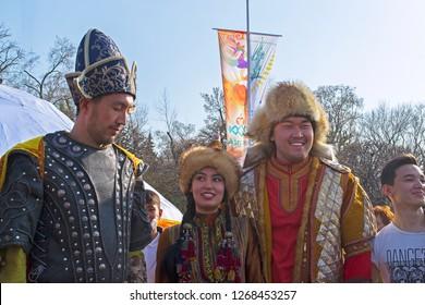Almaty, Kazakhstan - 22 March 2016: People in national Kazakh costumes at celebration of Nauryz