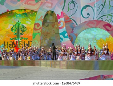 Almaty, Kazakhstan - 22 March 2016: Musicians in Kazakh costumes in street performance at celebration of Nauryz. Words: 'Nauryz'