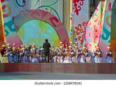 Almaty, Kazakhstan - 22 March 2016: Musicians in Kazakh costumes in street performance at celebration of Nauryz.