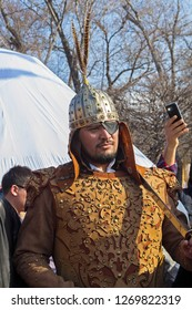 Almaty, Kazakhstan - 22 March 2016: Man in costume of medievall Kazakh knight at celebration of Nauryz