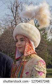 Almaty, Kazakhstan - 22 March 2016: Young woman in national Kazakh costume at celebration of Nauryz