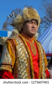 Almaty, Kazakhstan - 22 March 2016: Young man in colorful costume of medieval Kazakh warrior at celebration of Nauryz
