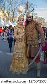Almaty, Kazakhstan - 22 March 2016: Young woman & man in costumes of Kazakh medieval princess & knight at celebration of Nauryz. Words: 'Nauryz'