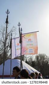 Almaty, Kazakhstan - 22 March 2016: Flags with emblems of Almaty & UNESCO at Nauryz celebration.