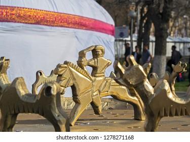 Almaty, Kazakhstan - 22 March 2016: Celebration of Nauryz: reconstruction of famous Scythian altar with 12 animals going around circle & hunter (Sun) in center. Symbol of solar calendar & spring
