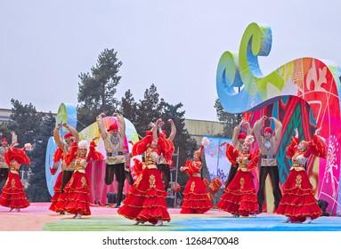 Almaty, Kazakhstan - 22 March 2017: People dancing in Kazakh costumes in street at celebration of Nauryz. Selective focus