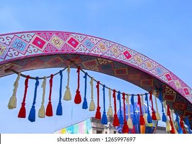 Almaty, Kazakhstan - 22 March 2018: Street decoration with elements of Kazakh yourt & air balloon at Nauryz celebration.