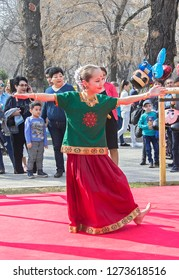 Almaty, Kazakhstan - 22 March 2018: Young girl performing Indian dance in street at celebration of Nauryz