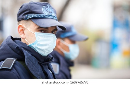 Almaty, Kazakhstan 31/03/2020:handsome military russian policeman stands on the street in an antiviral mask during a coronavirus