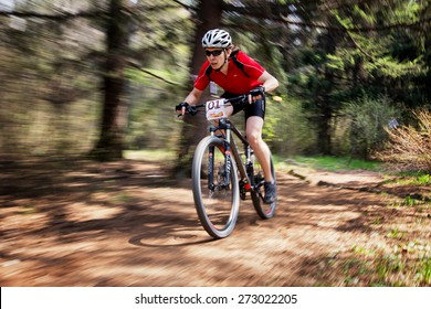 "ALMATY, KAZAKHSTAN - APRIL 19, 2015: M.Getmanchuk (N1) in action at cross-country competition ""Open season - Bikes relay 2015"""