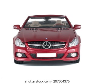 ALMATY, KAZAKHSTAN - APRIL 21, 2014: Collectible toy red Mercedes-Benz SL 550 cabriolet front view isolated on white background