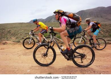 "ALMATY, KAZAKHSTAN - APRIL 29: V.Krechetov and other in action at Adventure mountain bike cross-country marathon in mountains ""Jeyran Trophy 2012"" April 29, 2012 in Almaty, Kazakhstan."