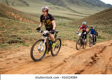 """ALMATY, KAZAKHSTAN - APRIL 30, 2016: V.Kachanov (N32) in action at Adventure mountain bike cross-country competition in mountains """"Jeyran Trophy 2016"""""""