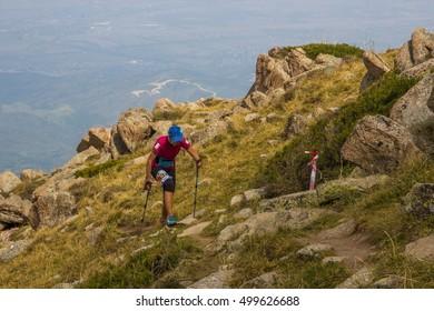 Almaty, Kazakhstan - August 20: Skyrunner runs in the mountains - Gorge Kim-Asar, Tien-Shan mountains, peak named Furmanova on August 20, 2016 in Almaty, Kazakhstan