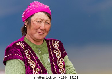 ALMATY, KAZAKHSTAN - AUGUST 24, 2017: Portrait of a nomadic woman in the plateau near Almaty, Kazakhstan.