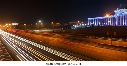 ALMATY, KAZAKHSTAN - February 24, 2016: Evening view of the Almaty city. Park of first president. Light trails on motorway highway at night.