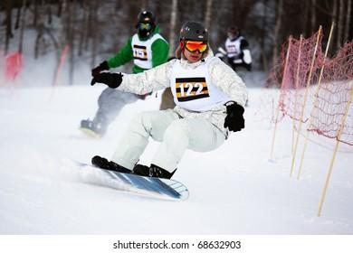 ALMATY, KAZAKHSTAN - JAN 8: Ilya Zagorodnyk (N122) in action at Ski and Boarder Cross competition on Ski Resort Akbulak, January 8, 2011 in Almaty, Kazakhstan.