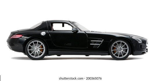 ALMATY, KAZAKHSTAN - June 22, 2014 - Collectible toy Mercedes-Benz SLS Sedan isolated on white background