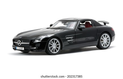 ALMATY, KAZAKHSTAN - june 22, 2014 - Collectible toy Mercedes-Benz SLS Sedan isolated on white background front view