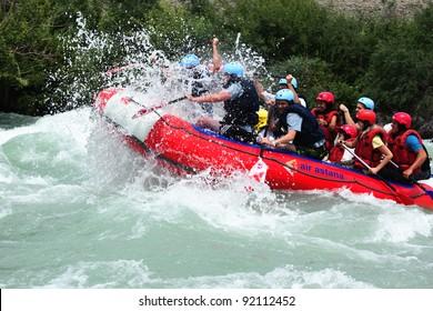 "ALMATY, KAZAKHSTAN - JUNE 27: ""Air Astana"" team in action at Rafting competition on Chilik river. June 27, 2011 in Almaty, Kazakhstan."