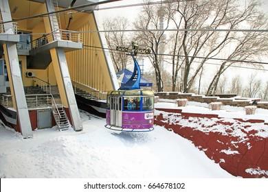 ALMATY, KAZAKHSTAN - MARCH 10, 2014: funicular with tourists in  Kok-Tube mount, Almaty, Kazakhstan