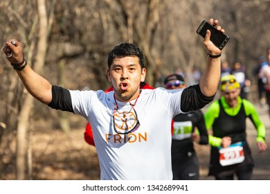 ALMATY, KAZAKHSTAN - March 16, 2019: portrait of a handsome mature unidentified man who runs through the woods during the spring marathon in the city of Almaty, in the grove named after Baum on March