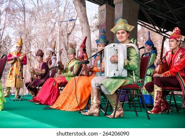 ALMATY, KAZAKHSTAN - MARCH 22, 2015: Musicians in Kazakh traditional costumes with national instruments on the stage at Nauryz celebration