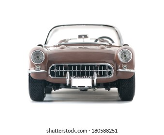 Almaty, Kazakhstan - March 6, 2014: Collectible toy car convertible Chevrolet Corvette 1957 on a white background