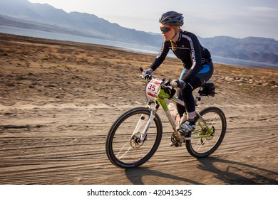 """ALMATY, KAZAKHSTAN - MAY 01, 2016: T.Sherbanenko (N35) in action at Adventure mountain bike cross-country competition in mountains """"Jeyran Trophy 2016"""""""